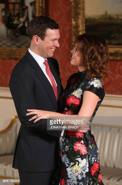 Britain's Princess Eugenie of York poses with her fiance Jack Brooksbank in the Picture Gallery at Buckingham Palace in London on January 22 after...