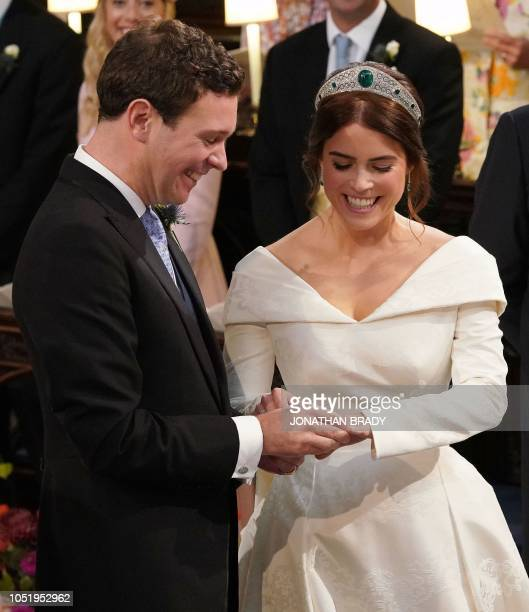 TOPSHOT Britain's Princess Eugenie of York reacts during her wedding ceremony to Jack Brooksbank at St George's Chapel Windsor Castle in Windsor on...