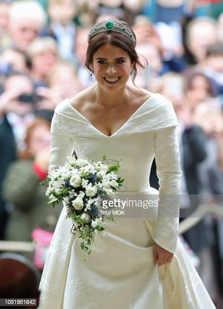 Britain's Princess Eugenie of York walks up the aisle during her wedding ceremony to Jack Brooksbank at St George's Chapel Windsor Castle in Windsor...
