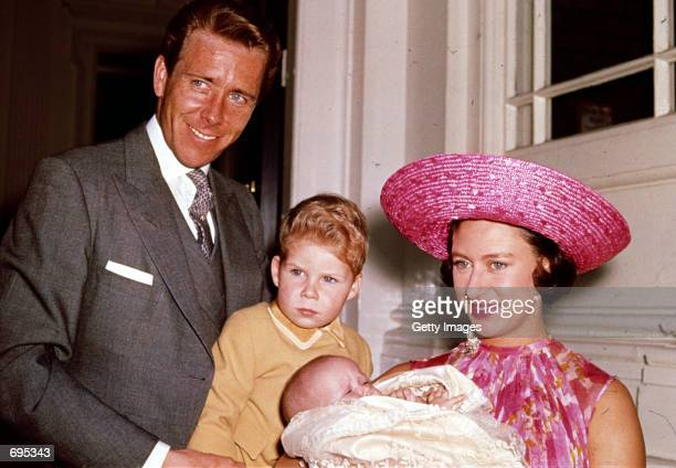 Britains Princess Margaret Lord Snowdon and Viscount Linley pose for a photograph with Margarets infant daughter Lady Sarah ArmstrongJones in 1964 at...