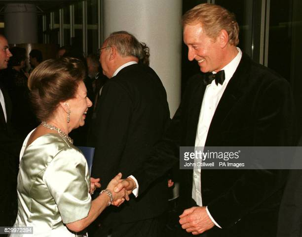 Britain's Princess Margaret shakes hands with actor Charles Dance at the Royal Festival Hall after attending a Royal Gala Concert to mark her sister...