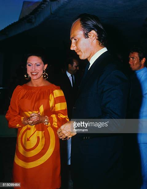 Britain's Princess Margaret with the Aga Khan August 18th at his vacation resort Lord Snowdon wearing blue jacket stands in the background