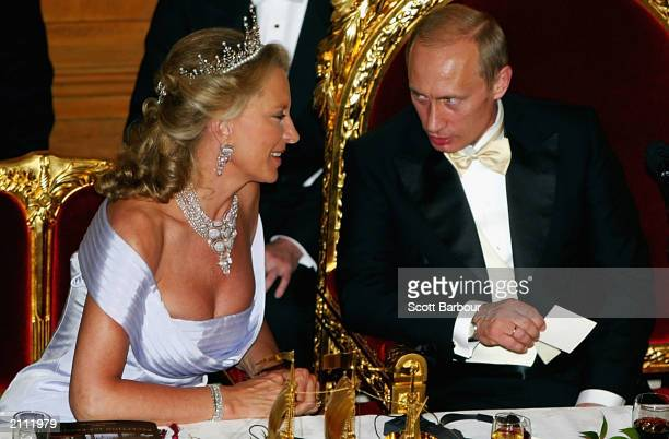 Britain's Princess Michael of Kent talks to Russian President Vladimir Putin during the Guildhall Banquet in Putin's honor June 25 2003 in London...