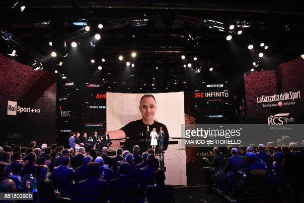 Britain's pro cyclist Christopher Froome is seen on a video screen during the presentation of the 2018 Tour of Italy cycling race on November 29 2017...