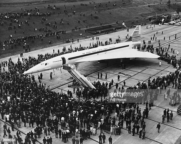 Britain's prototype of the Anglo-French supersonic Concorde airliner being rolled out of its hangar at the British Aircraft Corporation works at...