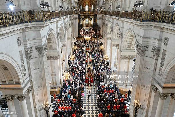Britain's Queen Britain's Queen Elizabeth II and Britain's Prince Philip Duke of Edinburgh are preceeded by a procession as they leave at the end of...
