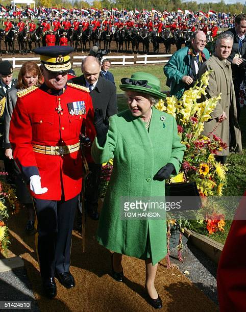 Britain's Queen Eizabeth II enjoys her tour of the Royal Canadian Mounted Police musical ride headquarters with RCMP commissioner Giuliano...