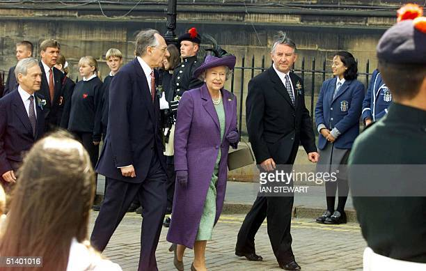 Britain's Queen Elizabeth 11 arrives to open the new Scottish Parliament in Edinburgh 01 July 1999 with Scottish First Minister Donald Dewar and the...