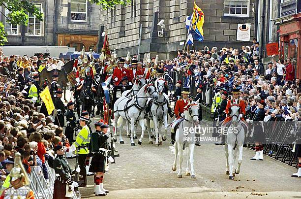 Britain's Queen Elizabeth 11 in a horsedrawn carriage arrives to open the new Scottish Parliament in Edinburgh 01 July 1999 The Queen opened the...