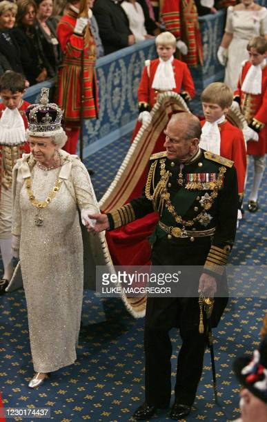 Britain's Queen Elizabeth and Prince Philip arrive for the 'State Opening of Parliament' in London, 15 November 2006. The British government will...