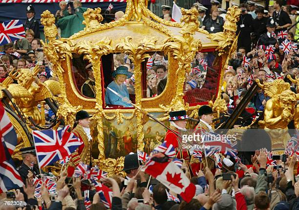 Britain's Queen Elizabeth and Prince Philip ride in the Golden State Carriage at the head of a parade from Buckingham Palace to St Paul's Cathedral...