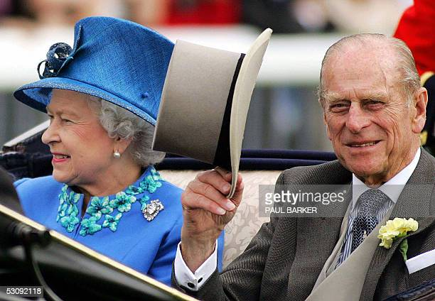 Britain's Queen Elizabeth and the Duke of Edinburgh arrive on the fourth day of the Royal Ascot meeting being held at York Racecourse in York,...