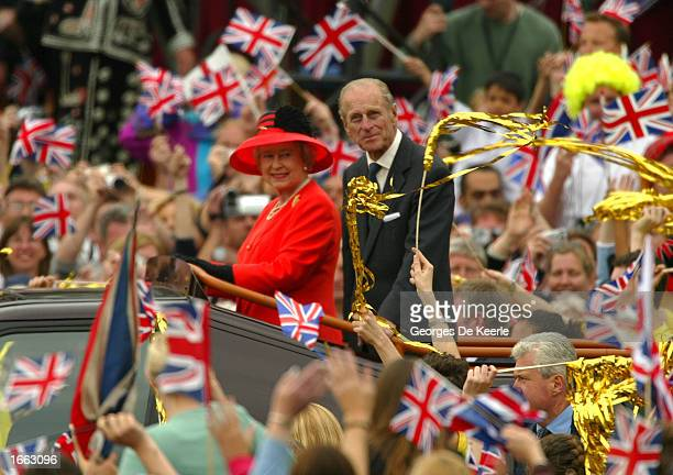 Britain's Queen Elizabeth and the Duke of Edinburgh ride at the head of a parade celebrating her Golden Jubilee to Buckingham Palace June 4, 2002...