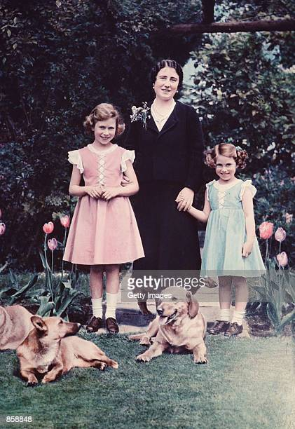 Britain's Queen Elizabeth center poses with her two daughters Princess Elizabeth left and Princess Margaret in June 1936 in the garden of the Royal...