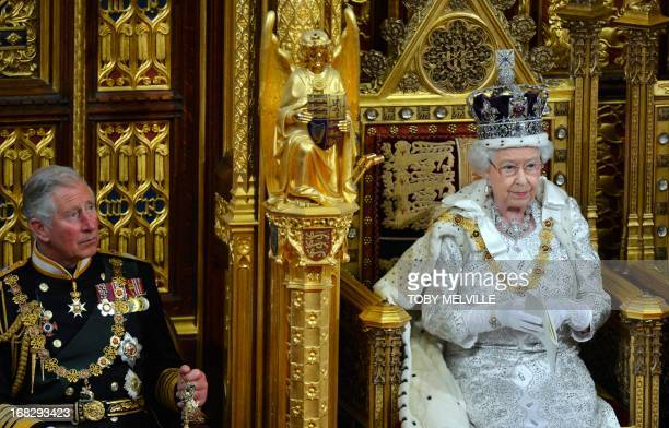 Britain's Queen Elizabeth delivers her speech during the State Opening of Parliament at the House of Lords, alongside Prince Charles in London May 8,...