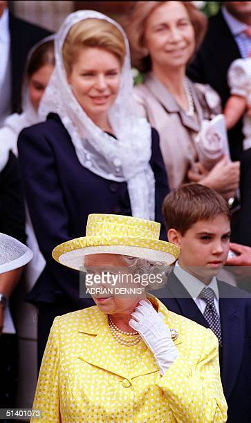 Britain's Queen Elizabeth departs St.Sophia Cathedral as Jordan's Queen Noor and Spain's Queen Sophia watch after they attended the wedding of...