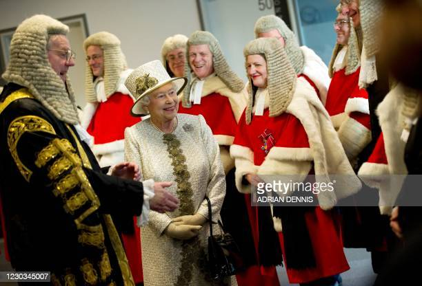Britain's Queen Elizabeth greets High Court judges as she officially opens the Rolls Building, the latest addition to the Royal Courts of Justice in...