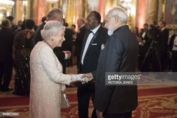 Britain's Queen Elizabeth greets India's Prime Minister Narendra Modi before The Queen's Dinner during The Commonwealth Heads of Government Meeting...