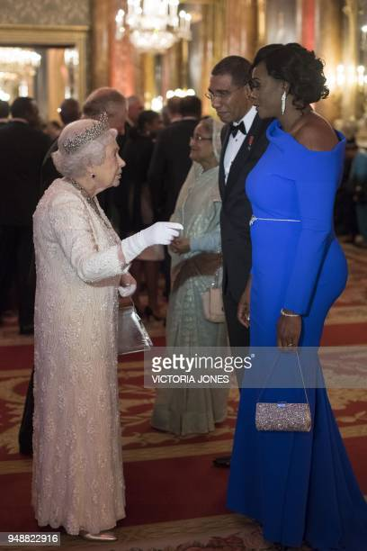 Britain's Queen Elizabeth greets Jamaica's Prime Minister Andrew Holness and his wife Juliet before The Queen's Dinner during The Commonwealth Heads...