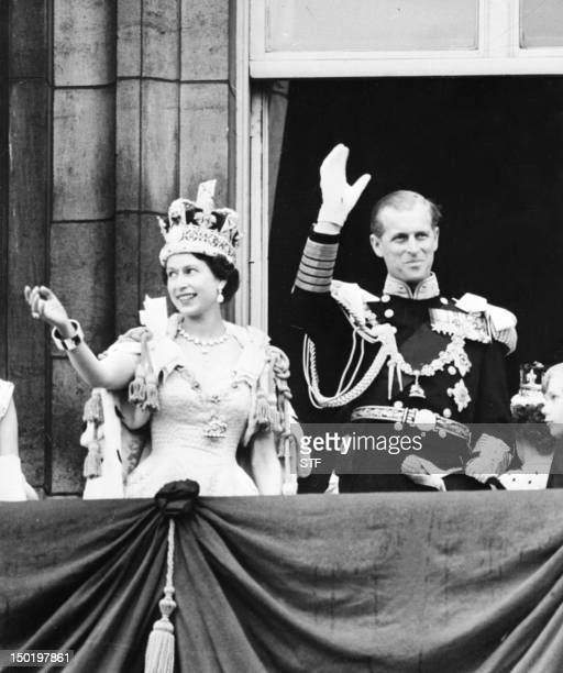 Britain's Queen Elizabeth II accompanied by Britain's Prince Philip Duke of Edinburgh waves to the crowd June 2 1953 after being crowned at...