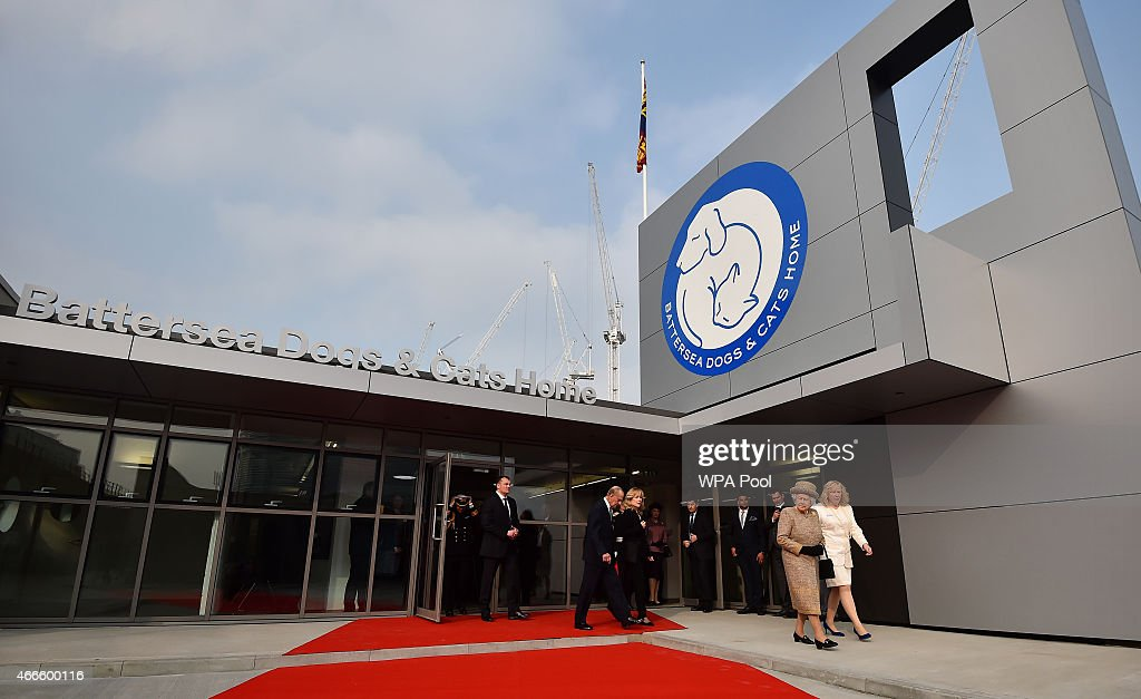 Britain's Queen Elizabeth II accompanied by Britain's Prince Philip, Duke of Edinburgh are accompanied by Chief Executive Officer Claire Horton (R) as they attend the opening of the new Mary Tealby dog kennels at Battersea Dogs and Cats Home in London on March 17, 2015.