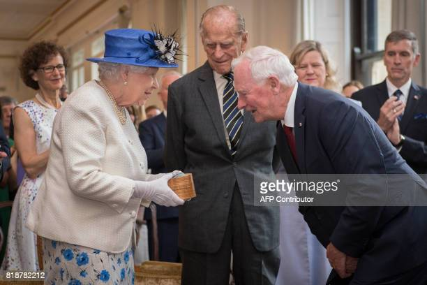 Britain's Queen Elizabeth II, accompanied by Britain's Prince Philip, Duke of Edinburgh, is welcomed by Canada Governor General David Johnston on a...