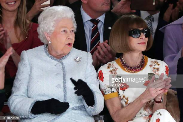TOPSHOT Britain's Queen Elizabeth II accompanied by BritishAmerican journalist and editor Anna Wintour views British designer Richard Quinn's runway...
