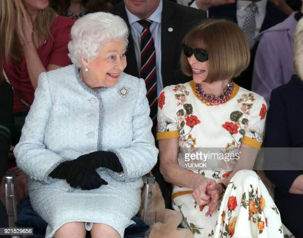 Britain's Queen Elizabeth II accompanied by BritishAmerican journalist and editor Anna Wintour views British designer Richard Quinn's runway show...