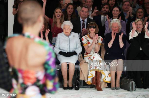 TOPSHOT Britain's Queen Elizabeth II accompanied by BritishAmerican journalist and editor Anna Wintour and royal dressmaker Angela Kelly views...