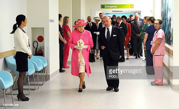 Britain's Queen Elizabeth II accompanied by chairman Tony Beddison inspects the new Royal Children's Hospital meeting with a small group of ill...