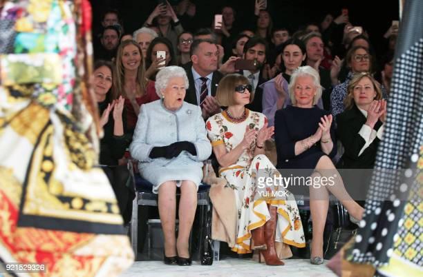 Britain's Queen Elizabeth II accompanied by Chief Executive of the British Fashion Council Caroline Rush BritishAmerican journalist and editor Anna...