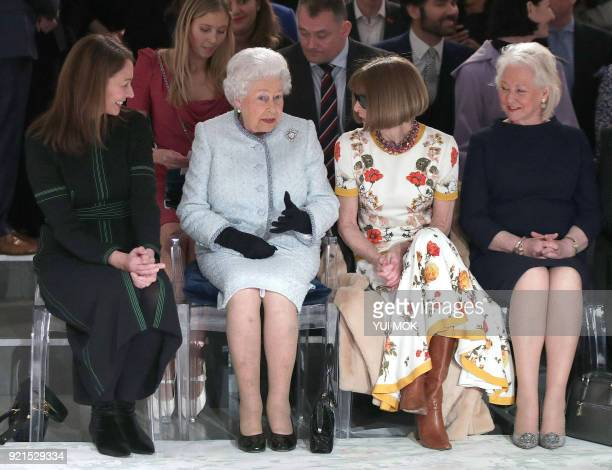 Britain's Queen Elizabeth II accompanied by Chief Executive of the British Fashion Council Caroline Rush BritishAmerican journalist and editor Anna...