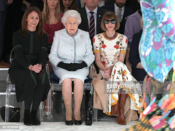 Britain's Queen Elizabeth II accompanied by Chief Executive of the British Fashion Council Caroline Rush and BritishAmerican journalist and editor...