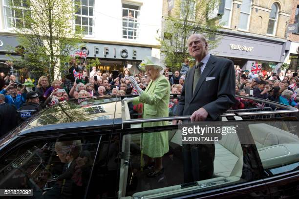 Britain's Queen Elizabeth II accompanied by her husband Prince Philip Duke of Edinburgh greet wellwishers during a 'walkabout' on her 90th birthday...