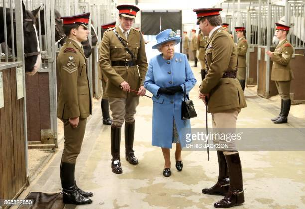 Britain's Queen Elizabeth II accompanied by Lieutenant Colonel James Gaselee Commanding Officer Household Cavalry Mounted Regiment reacts as she...
