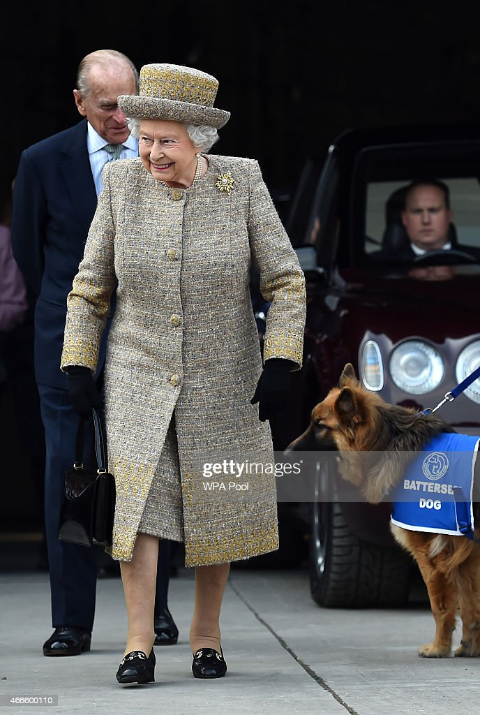 Britain's Queen Elizabeth II accompanied by Prince Philip, Duke of Edinburgh arrive to attend the opening of the new Mary Tealby dog kennels at Battersea Dogs and Cats Home in London on March 17, 2015.