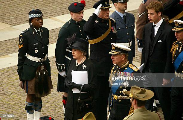 Britain's Queen Elizabeth II accompanied by Prince Phillip Prince William and Prince Charles leaves for Windsor Castle after the state funeral of the...