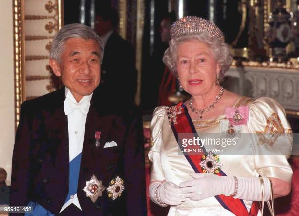 Britain's Queen Elizabeth II accompanies Japanese Emperor Akihito to the State Banquet Hall at Buckingham Palace late 26 May. The Japanese Emperor is...