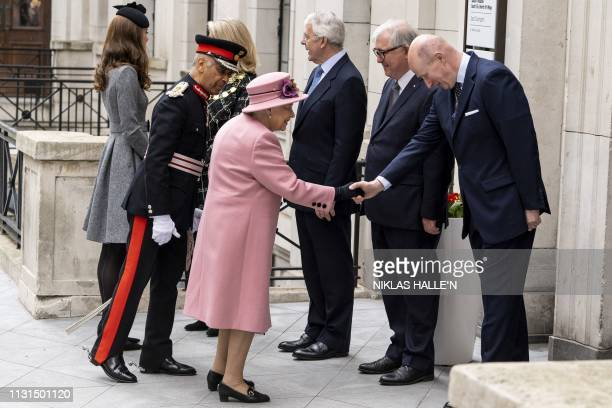 Britain's Queen Elizabeth II and Britain's Catherine Duchess of Cambridge are met by Lord Mayor of Westmnster councillor Lindsay Hall former British...