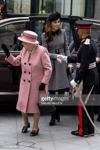 Britain's Queen Elizabeth II and Britain's Catherine Duchess of Cambridge arrive for a visit to Kings College to open Bush House the latest education...