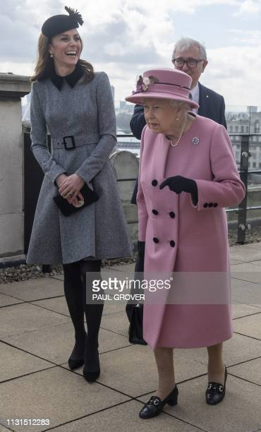 Britain's Queen Elizabeth II and Britain's Catherine Duchess of Cambridge visit Kings College to open Bush House the latest education and learning...