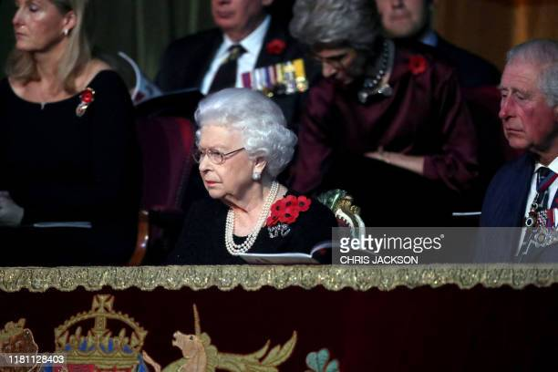 Britain's Queen Elizabeth II and Britain's Prince Charles Prince of Wales attend the annual Royal British Legion Festival of Remembrance at the Royal...