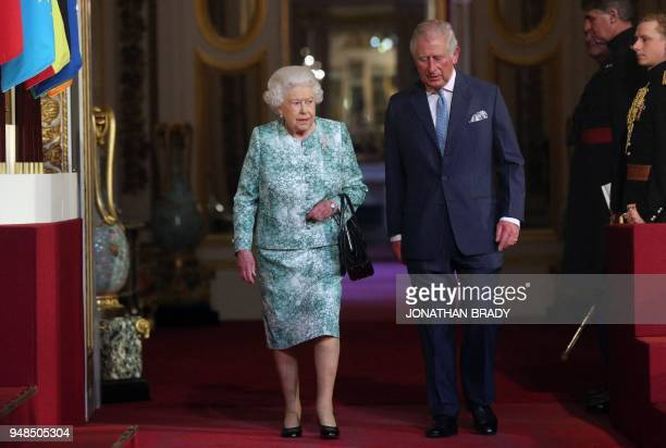 TOPSHOT Britain's Queen Elizabeth II and Britain's Prince Charles Prince of Wales arrive for the formal opening of the Commonwealth Heads of...