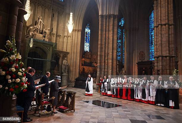 Britain's Queen Elizabeth II and Britain's Prince Philip Duke of Edinburgh attend a Service on the Eve of the Centenary of the Battle of the Somme at...