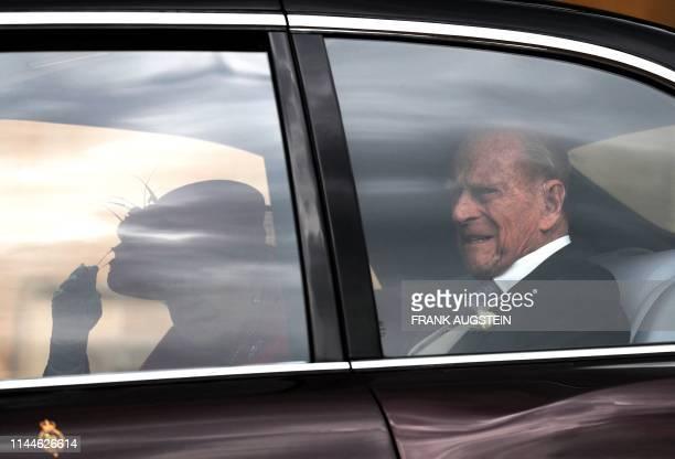 Britain's Queen Elizabeth II and Britain's Prince Philip Duke of Edinburgh arrive at St George's Chapel in Windsor Castle Windsor west of London on...