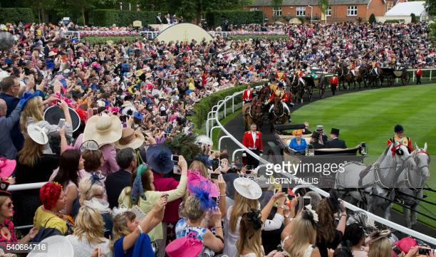 Britain's Queen Elizabeth II and Britain's Prince Philip Duke of Edinburgh arrive by carriage on Ladies Day of the Royal Ascot horse racing meet in...