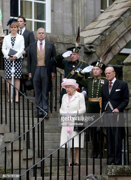Britain's Queen Elizabeth II and Britain's Prince Philip Duke of Edinburgh accompanied by the Britain's Prince Andrew Duke of York and First Minister...