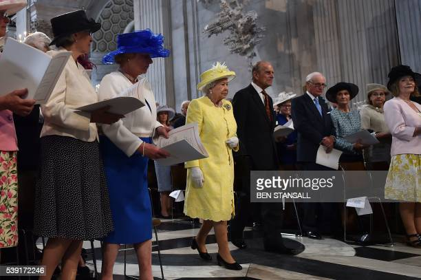 Britain's Queen Elizabeth II and Britain's Prince Philip, Duke of Edinburgh arrive for a national service of thanksgiving for the 90th birthday of...