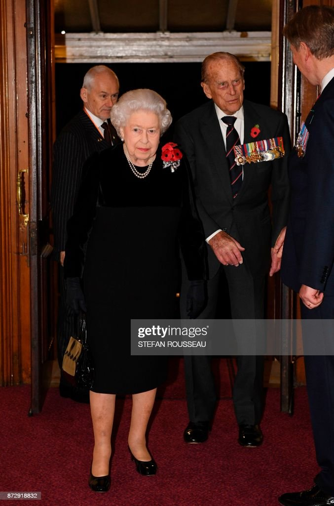 Britain's Queen Elizabeth II (L) and Britain's Prince Philip, Duke of Edinburgh (R) arrive for the the annual Royal Festival of Remembrance at the Royal Albert Hall in London on November 11, 2017 on Armistice Day. The Queen, accompanied by His Royal Highness The Duke of Edinburgh and other members of the Royal Family attended the annual Royal Festival of Remembrance at the Royal Albert Hall. The anniversary of Armistice Day, November 11, 1918, is marked in Britain with a number of events and acts of remembrance to honour those who fell in the two World Wars and subsequent conflicts. The red poppy is worn to symbolise the poppies which grew on French and Belgian battlefields during World War I. / AFP PHOTO / POOL / Stefan Rousseau