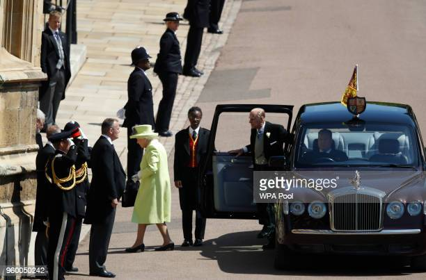 Britain's Queen Elizabeth II and Britain's Prince Philip, Duke of Edinburgh arrive for the wedding ceremony of Prince Harry and US actress Meghan...